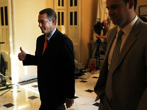 House Speaker John Boehner gives a thumbs up after the chamber passed his plan Friday to raise the debt ceiling and cut spending. The Senate voted to kill the measure a short time later.