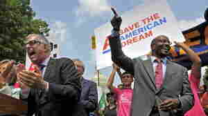 Van Jones (right) of the American Dream Movement, points skyward during a sing-along in front of the Capitol to urge lawmakers to come to a fair deal on the budget on Thursday. At the microphone is Joel Silberman, also with the American Dream Movement.