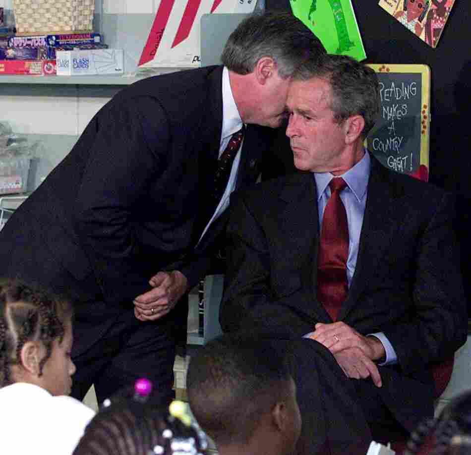 President Bush's Chief of Staff Andy Card tells the president of the plane crashes into the World Trade Center, during a visit to the Emma E. Booker Elementary School in Sarasota,  Fla., on Sept. 11, 2001.