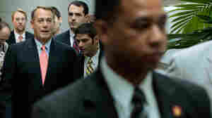 Speaker of the House John Boehner  walks to a House GOP caucus meeting July 29, 2011 in Washington, DC.
