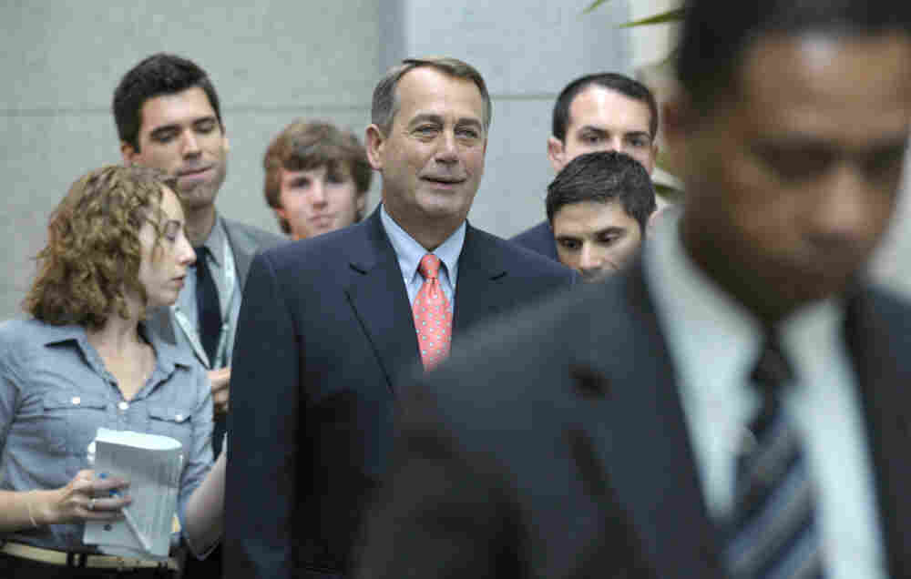 House Speaker John Boehner of Ohio walks to a caucus meeting on Capitol Hill in Washington.