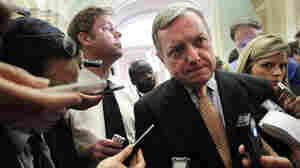 U.S. Senate Majority Whip Richard Durbin (D-IL) is surrounded by reporters at the Capitol Friday after a briefing on the debt ceiling.