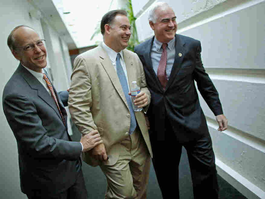 Rep. Greg Walden (R-OR) (L) and Rep. Patrick Meehan (R-PA) (R) pretend to twist the arms of Rep. Frank Guinta (R-NH), July 29. 2011.