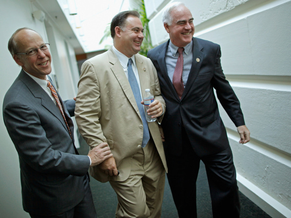 Rep. Greg Walden (R-OR) (L) and Rep. Patrick Meehan (R-PA) (R) pretend to twist the arms of Rep. Frank Guinta (R-NH), July 29. 2011. (Getty Images)