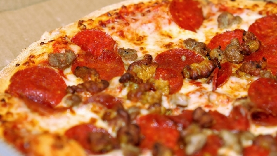 As debt talks continue, a Capitol Hill pizza place is inundated with orders.