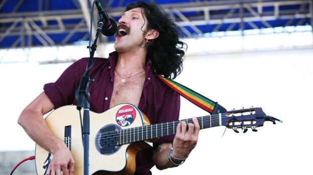 Eugene Hutz of Gogol Bordello performs at the 2011 Newport Folk Festival.