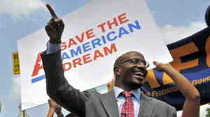 Van Jones (right) of the American Dream Movement, rallies with federal employees and progressive groups in front of the Capitol on Thursday, urging lawmakers to come to a fair deal on  the budget.