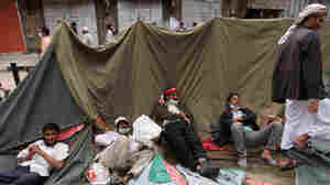 Anti-government protesters rest on their collapsed tent following clashes with the police as they called for the resignation of  President Ali Abdullah Saleh in Sanaa, Yemen.