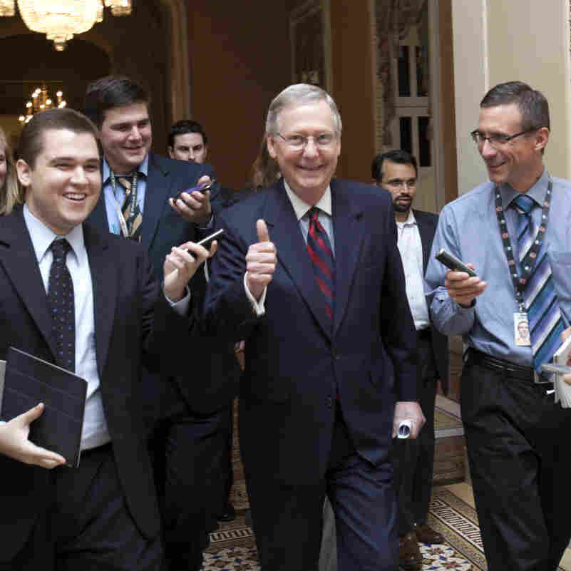 Senate Minority Leader Mitch McConnell, R-Ky., is all smiles as he walks to the Senate floor to announce that a deal has been reached on the debt ceiling on Capitol Hill in Washington, Sunday, July 31, 2011.
