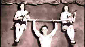 Physical instructor Charles Russell demonstrates his strength, May 18, 1939.