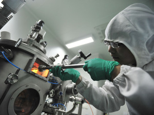A researcher works at the Wuhan National Laboratory for Optoelectronics in central China's Hubei province on June 9. Beijing's spending on research and development has increased over the past few years in an effort to re-establish the country's scientific prowess.
