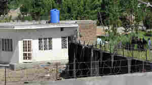 Policemen stand guard outside the compound used as a hideout by Osama bin Laden, the day after a U.S. raid killed the al Qaida leader in Abbottabad, Pakistan.