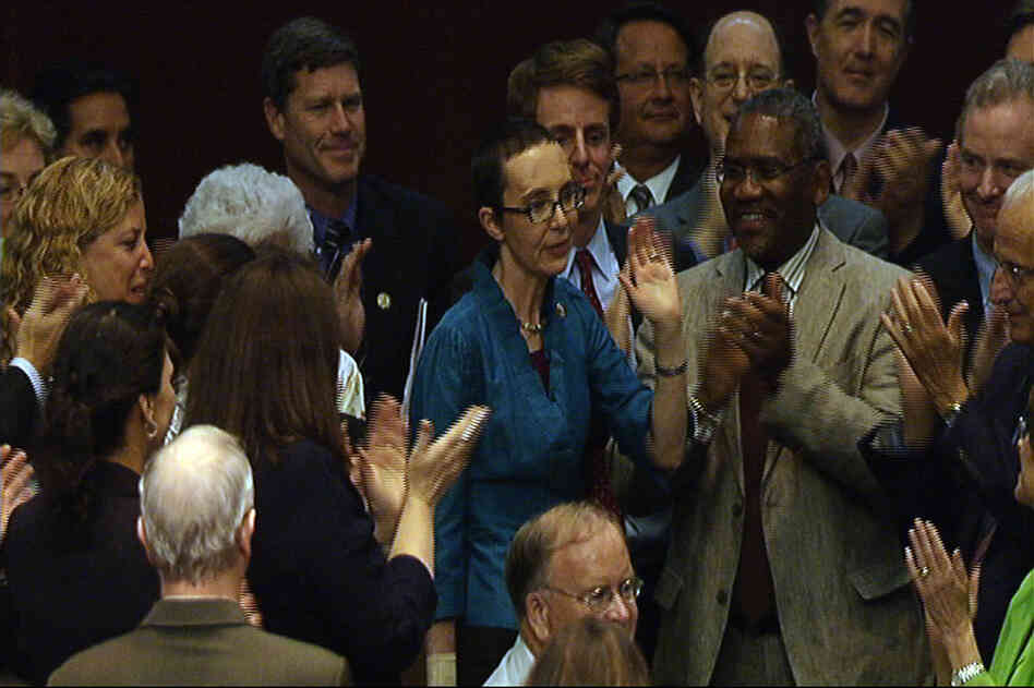 Rep. Gabrielle Giffords (D-AZ) waves to her House colleagues after voting for a bill to raise the federal debt ceiling, in this image from House Television.