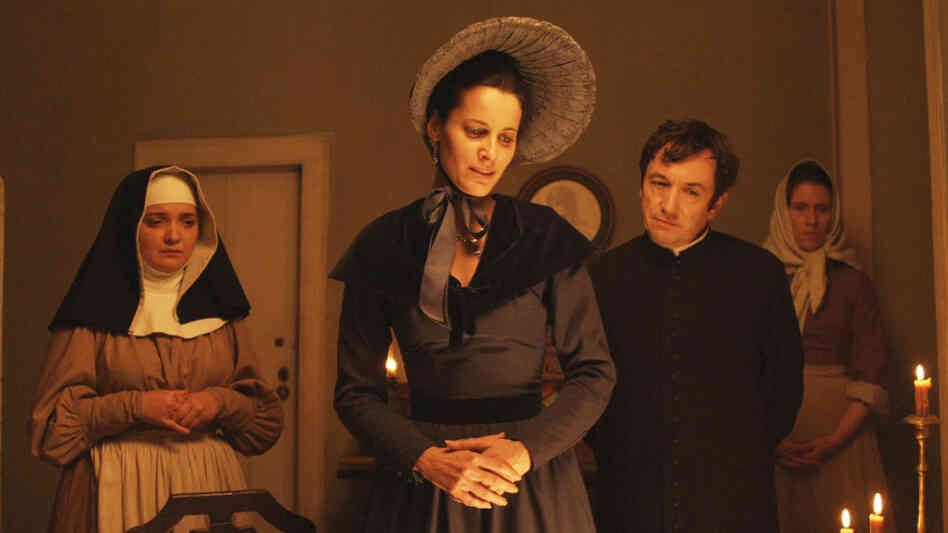 Moving In Mysterious Ways: Over the course of its 4 1/2 hours, the film tracks, abandons and reconnects with characters of various social classes, including Angela de Lima (Maria Joao Bastos, center), mother to protagonist Pedro, and Father Dinis (Adriano Luz), who looks after Pedro as a boy.