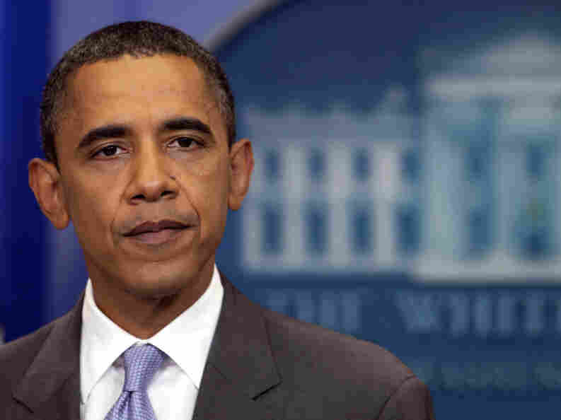 President Obama pauses as he speaks about the deal to raise the debt limit in the White House briefing room on Sunday.