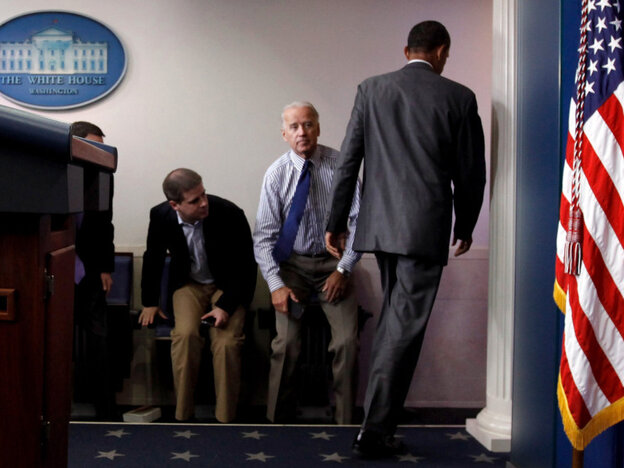 President Obama walks past Vice President Joe Biden and aide Dan Pfeiffer in the briefing room Sunday.