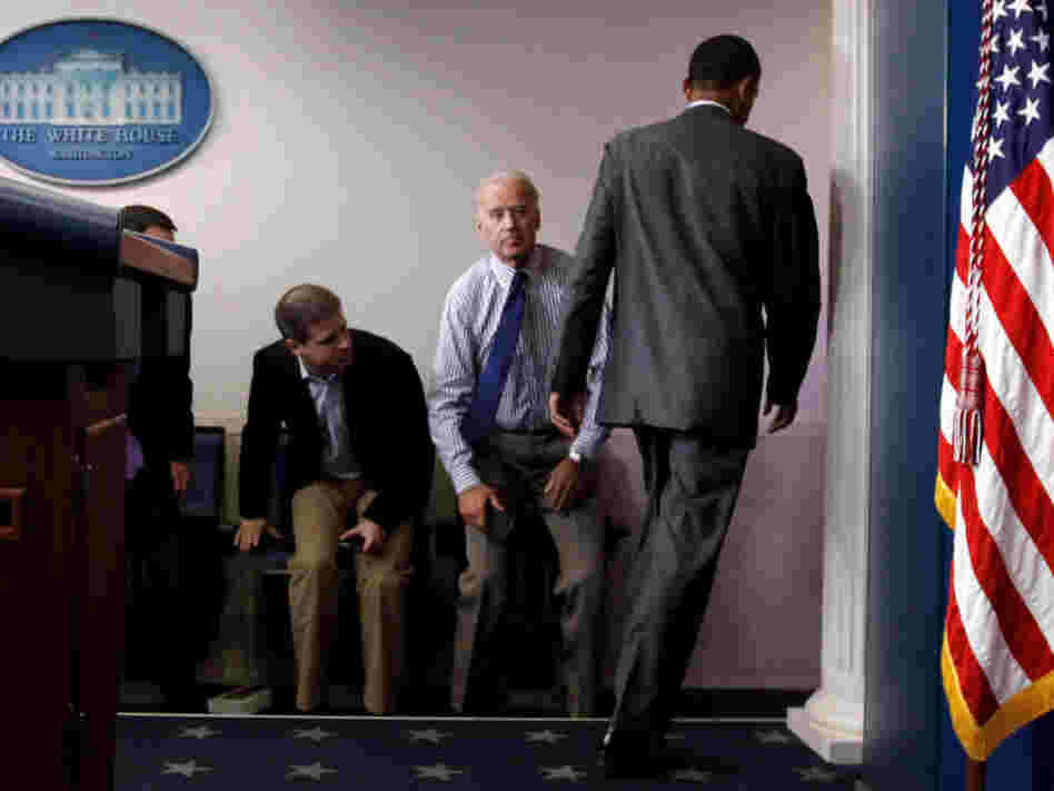 President Obama walks past Vice President Joe Biden and aide Dan Pfeiffer in the briefing room Sunday.