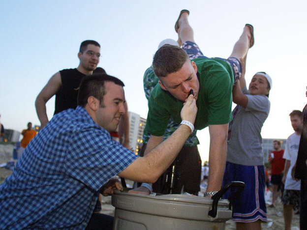 College students aid a colleague as he performs a keg stand in this file photo. Princeton Review released its new list