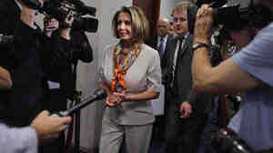The House voted Monday to extend the federal debt limit and enact spending cuts. Here, House Minority Leader Nancy Pelosi arrives for a meeting with House Democrats and Vice President Joe Biden at the Capitol.