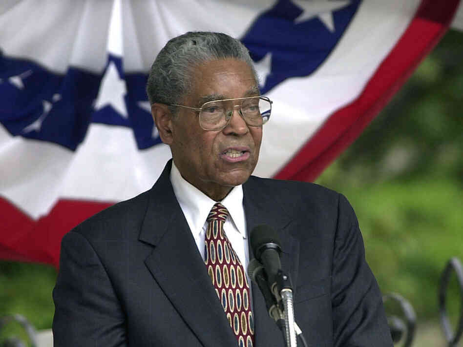 In 2004, the federal courthouse where U.S. District Judge Matthew Perry worked was named after him. Here, Perry speaks at the dedication ceremony.