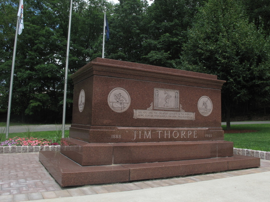 Jim Thorpe's rose-colored granite tomb sits alongside Pennsylvania Route 903 in Jim Thorpe, Pa. (NPR)