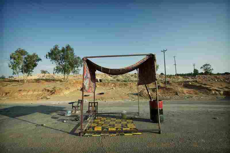 """What emerged as a running theme,"" says Levinson, ""was the level of ingenuity ... which has survived even in the face of food shortages and the obvious hardships."" Here, an improvised shelter is seen at a rebel checkpoint in the Nafusa Mountains."