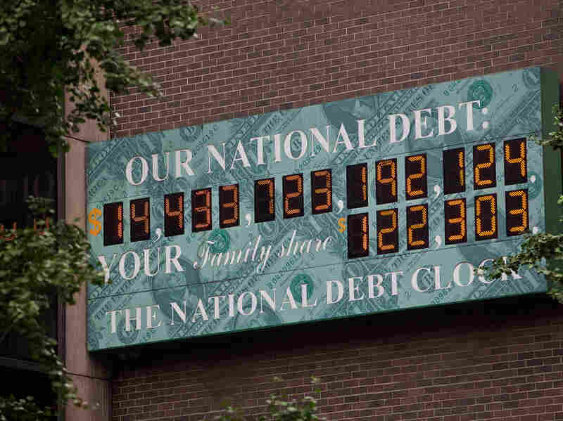 The National Debt Clock, a billboard-size digital display showing the increasing U.S. debt, is seen in New York City on Monday. Congress passed a bill Tuesday that would raise the nation's debt limit.