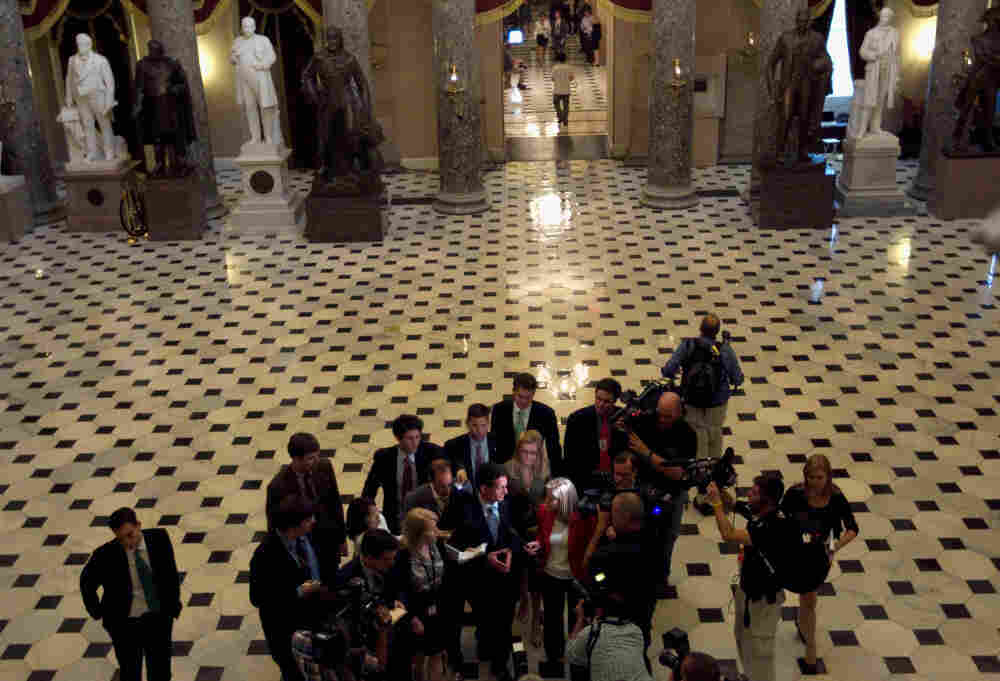 House Majority Leader Eric Cantor (R-VA) speaks with reporters after the House voted to raise the debt ceiling.