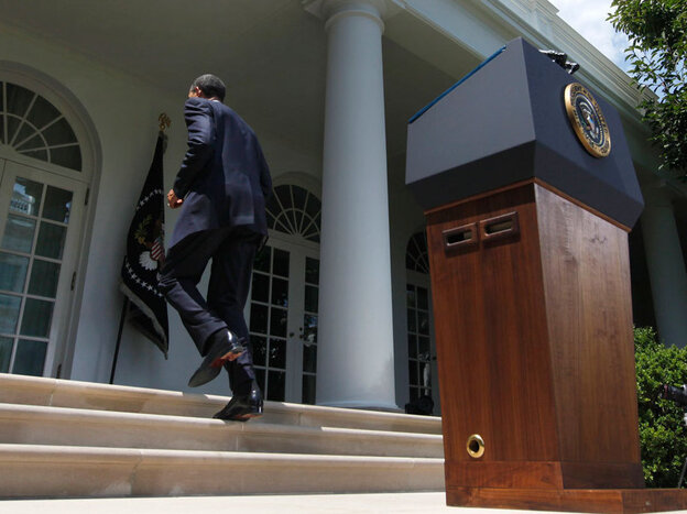 President Obama walks back to the Oval  Office after speaking about the Senate's passage of debt-ceiling legislation, at the White House on Tuesday.