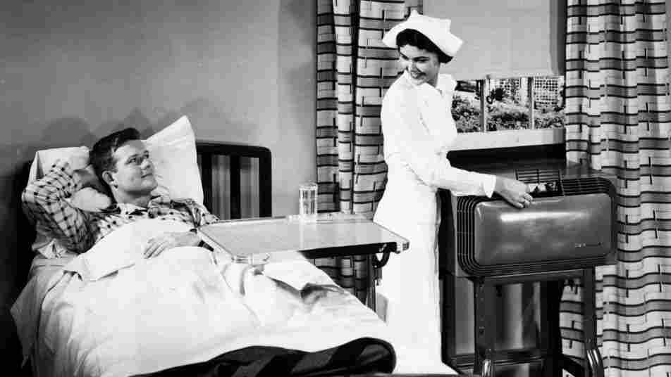 A nurse adjusts the air conditioning for the comfort of the patient in a hospital room during the 1950s. By 1953, over 1 million air conditioning units had been sold in the U.S.