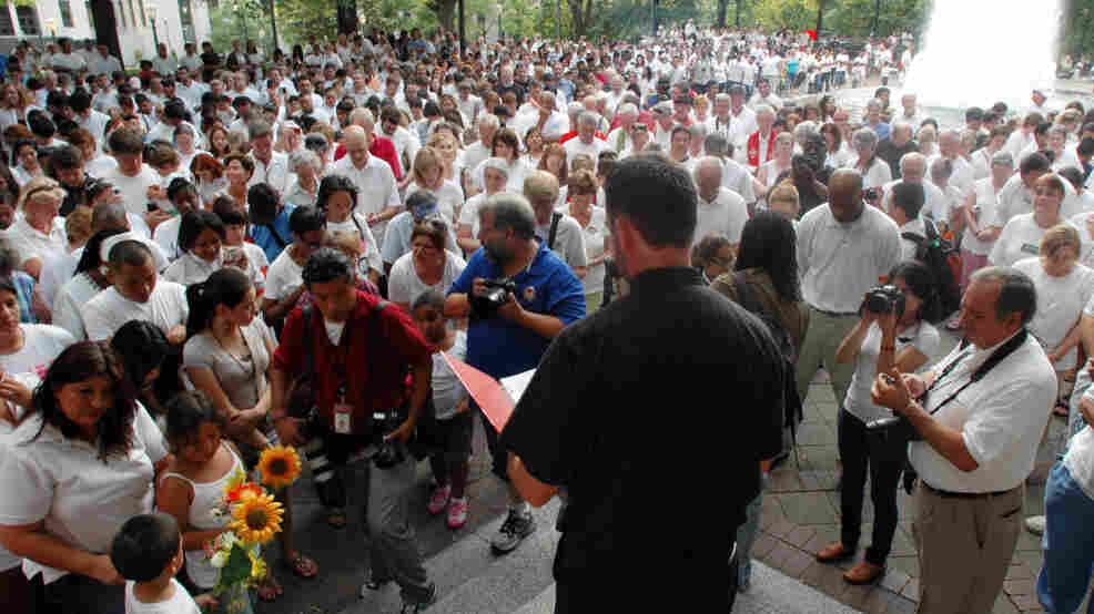 In June, participants bow their heads in prayer during a demonstration in Birmingham, Ala., to protest the state's new law against illegal immigration.