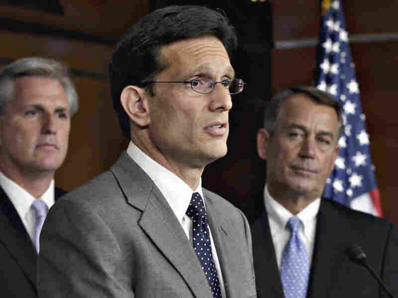 From left to right, House Majority Whip Kevin McCarthy, House Majority Leader Eric Cantor, and House Speaker John Boehner speaks to reporters about the debt crisis showdown during a news conference on Capitol Hill in Washington.