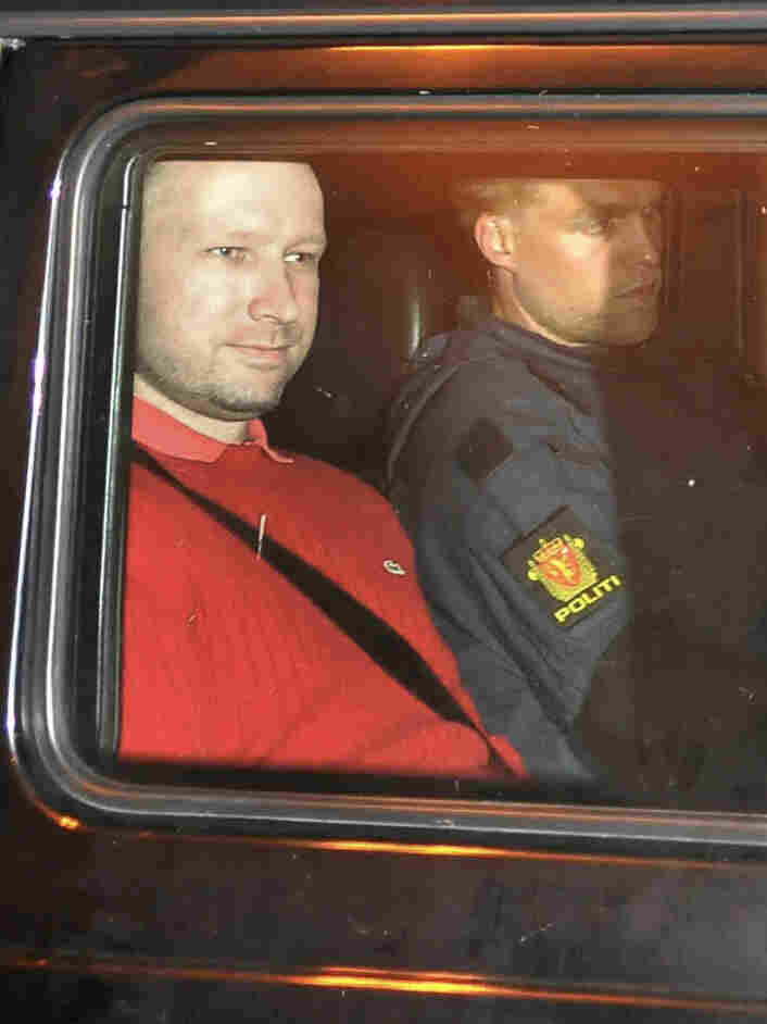 Anders Behring Breivik, left, leaves an Oslo courthouse in a police car after a hearing. Since then, Breivik has been held in solitary confinement.