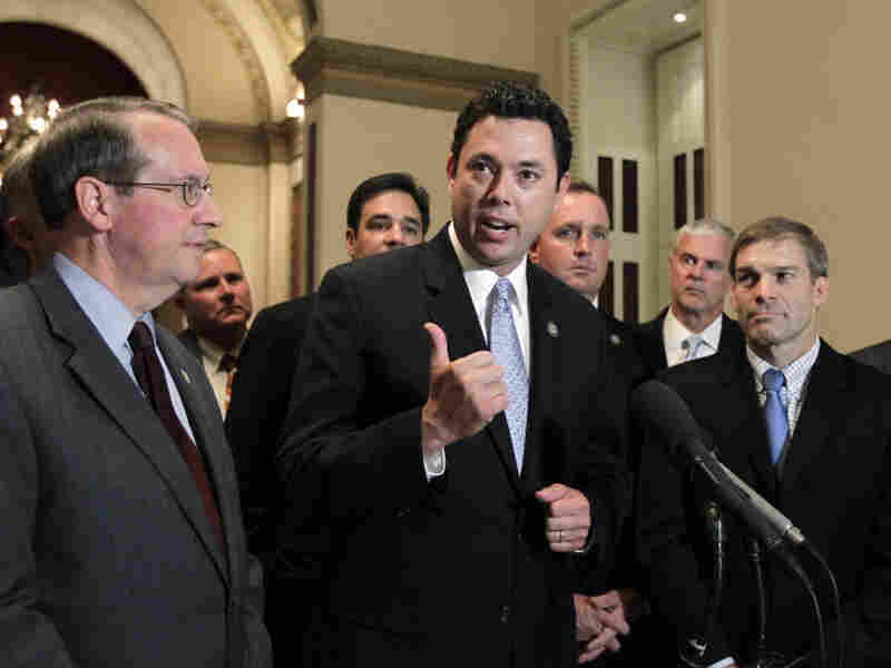 Rep. Jason Chaffetz (R-UT, center) and other House Republicans react to passage of the Cut, Cap and Balance bill on July 19. Chaffetz ultimately voted against the final debt-ceiling bill.