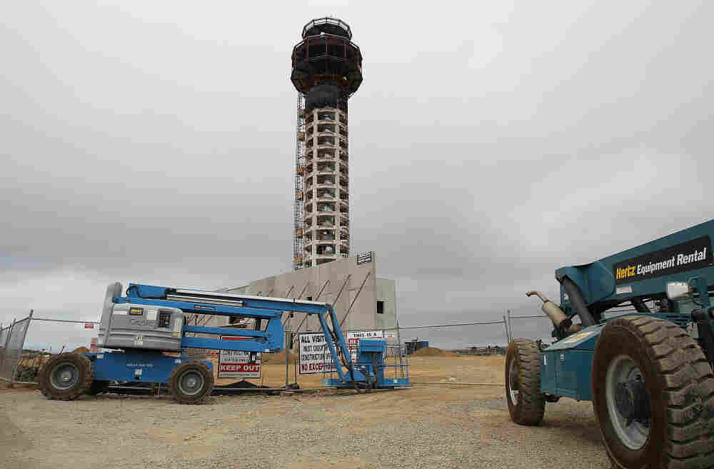 Construction equipment sits idle in front of the half-completed new control tower at Oakland International Airport. Thousands of construction workers on aviation projects have stopped work, as a standoff over funding of the FAA continues.