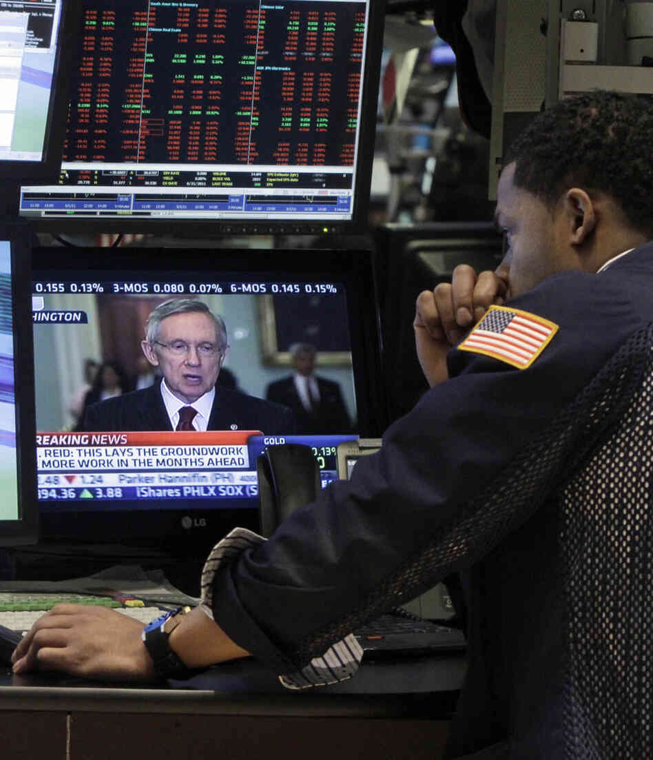 Sen. Harry Reid on a television on the floor of the New York Stock Exchange.