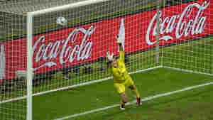 Team USA goalkeeper Hope Solo fails to save Japanese defender Saki Kumagai's goal during the FIFA Women's Football World Cup final match on July 17 in Germany. Japan won 3-1 in a penalty shootout after the final finished 2-2 in extra time.