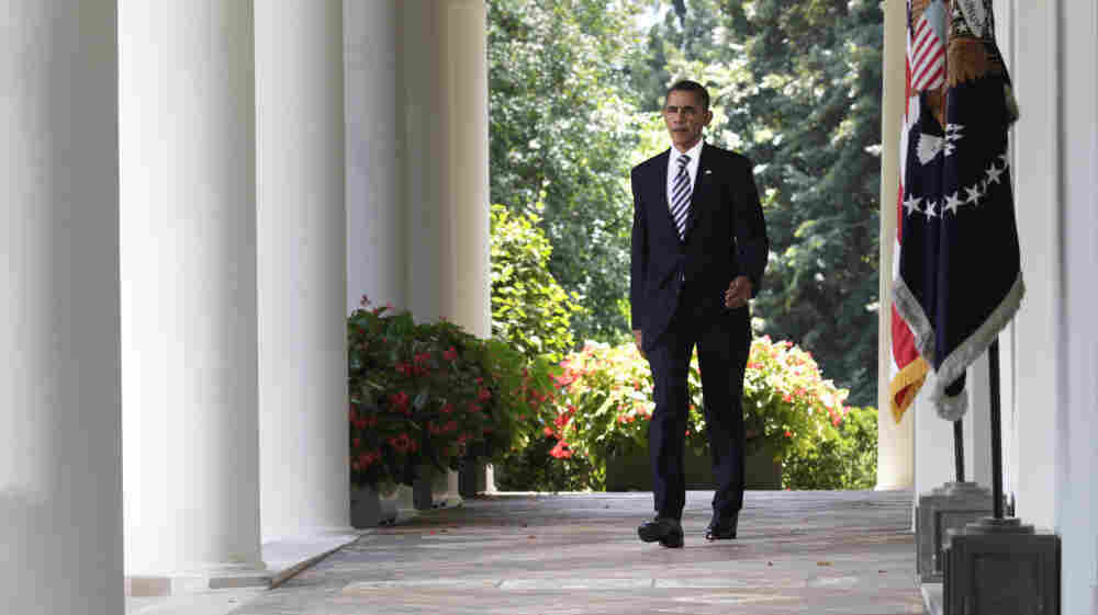 President Obama walks to the Rose Garden of the White House to discuss the debt-ceiling bill passed by the Senate.