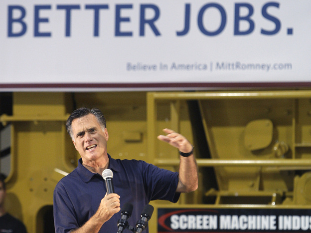 Former Massachusetts Gov. Mitt Romney speaks in the warehouse during a campaign stop in Pataskala, Ohio, last month. He opposed the debt-ceiling legislation signed by President Obama on Tuesday.