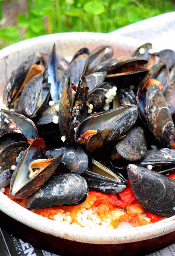 Grilled Mussels With Simmered Tomatoes Over Couscous