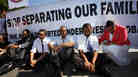 Supporters of the DREAM Act, including Rep. Luis Gutierrez, D-Ill., third from right, wait to be arrested while performing an act of civil disobedience at a rally for supporting the DREAM Act and immigration reform outside the White House in Washington, on Tuesday, July 26, 2011.