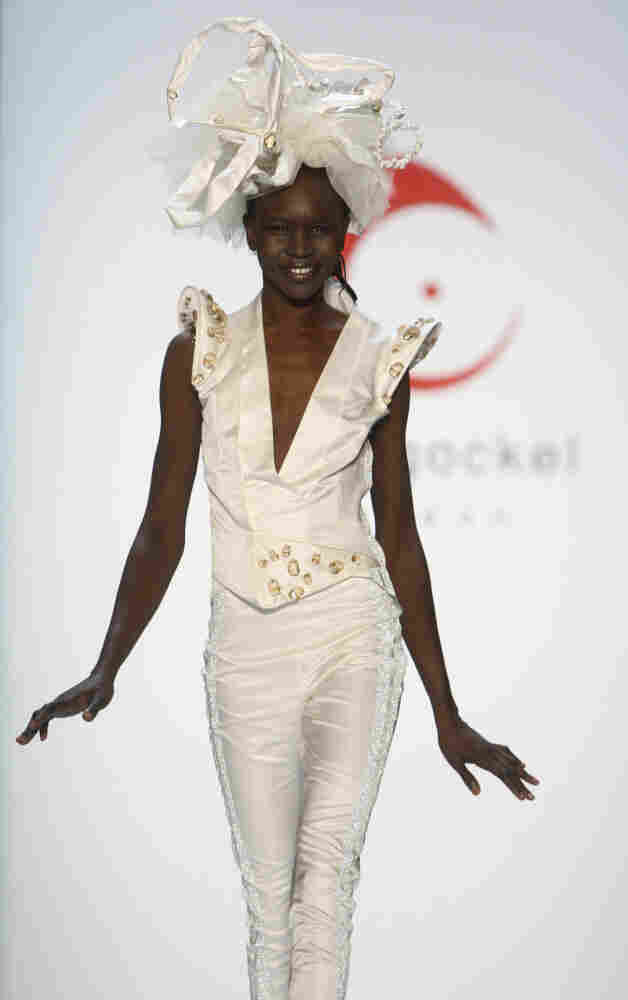 Sudan-born model Alek Wek displays a creation by German fashion designer Anja Gockel, at the Fashion Week in Berlin, Germany, Thursday, Jan. 21, 2010.