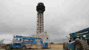 Construction equipment sits idle at the work site of a half-completed 236-foot FAA control tower at Oakland International Airport.