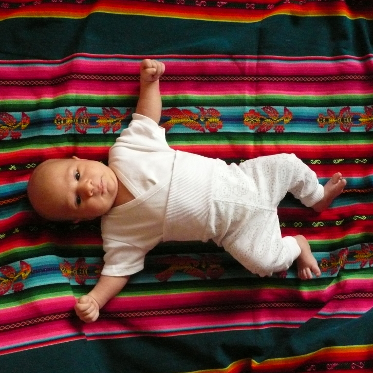 A baby lies on an aguayo, a traditional sling in Bolivia.