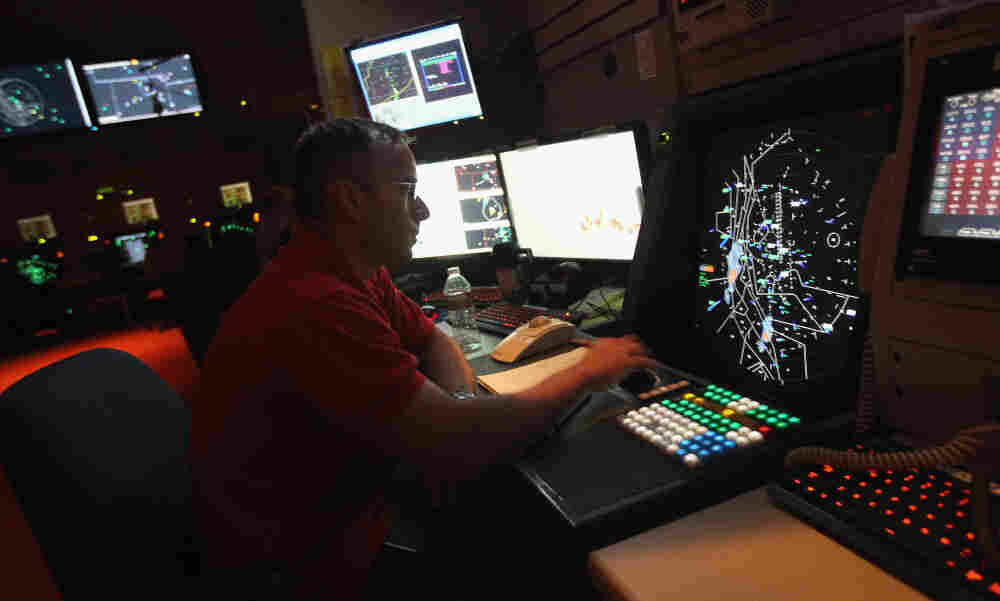 The FAA's partial shutdown doesn't affect air traffic controllers (above). But the impasse has left some 47,000 workers without a paycheck.