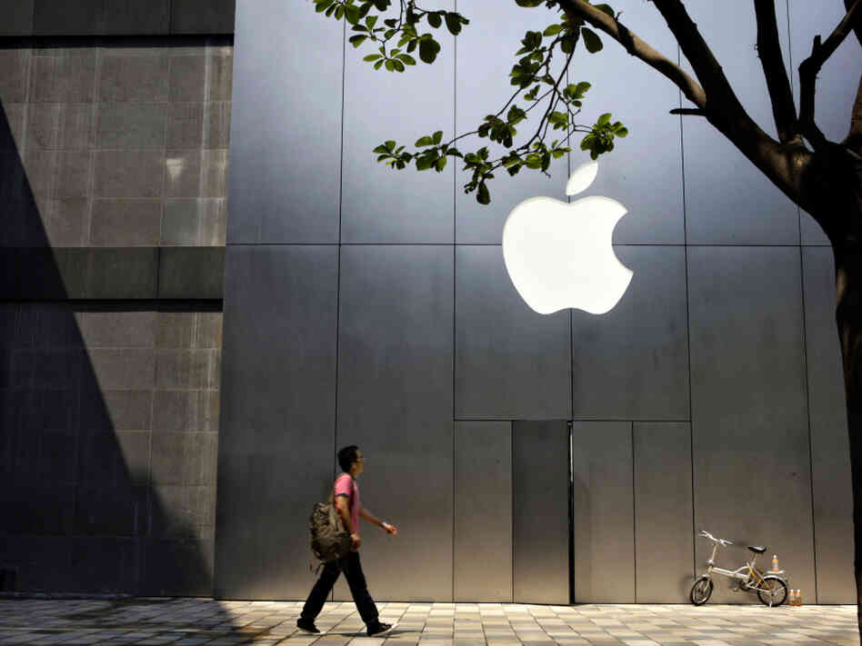 A man walks past Beijing's newly open Apple store Saturday, July 19, 2008. A chemical used on the glass screens of Apple products is causing health problems for employees.