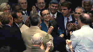 Rep. Gabrielle Giffords (D-AZ), center, is welcomed by her fellow members of the the House of Representatives as she appears on the floor for the first time since her shooting earlier this year.