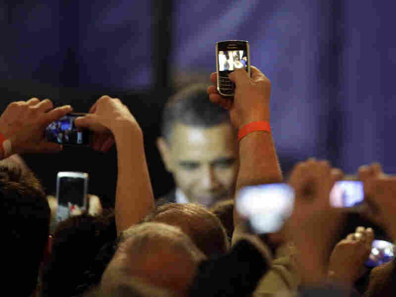 Supporters take photos of President Obama at a fundraising kickoff event in Chicago in April. During the heated debate over the debt ceiling, the president canceled several fundraisers in order to focus on negotiations.