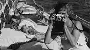 Aline Saarinen taking a photograph, circa 1955