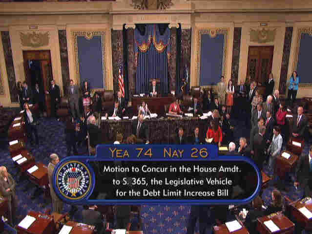 This video image provided by Senate Television shows the Senate floor on Capitol Hill in Washington, Tuesday, Aug. 2, 2011, after the Senate has approved an emergency bill to avert a first-ever government default with just hours to spare.